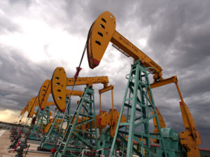 "CNPC ""nodding donkeys"" oil pumps pump oil during a storm in Daqing, Heilongjiang province, China, on July 13, 2006.  Photographer: LUCAS SCHIFRES/Bloomberg"