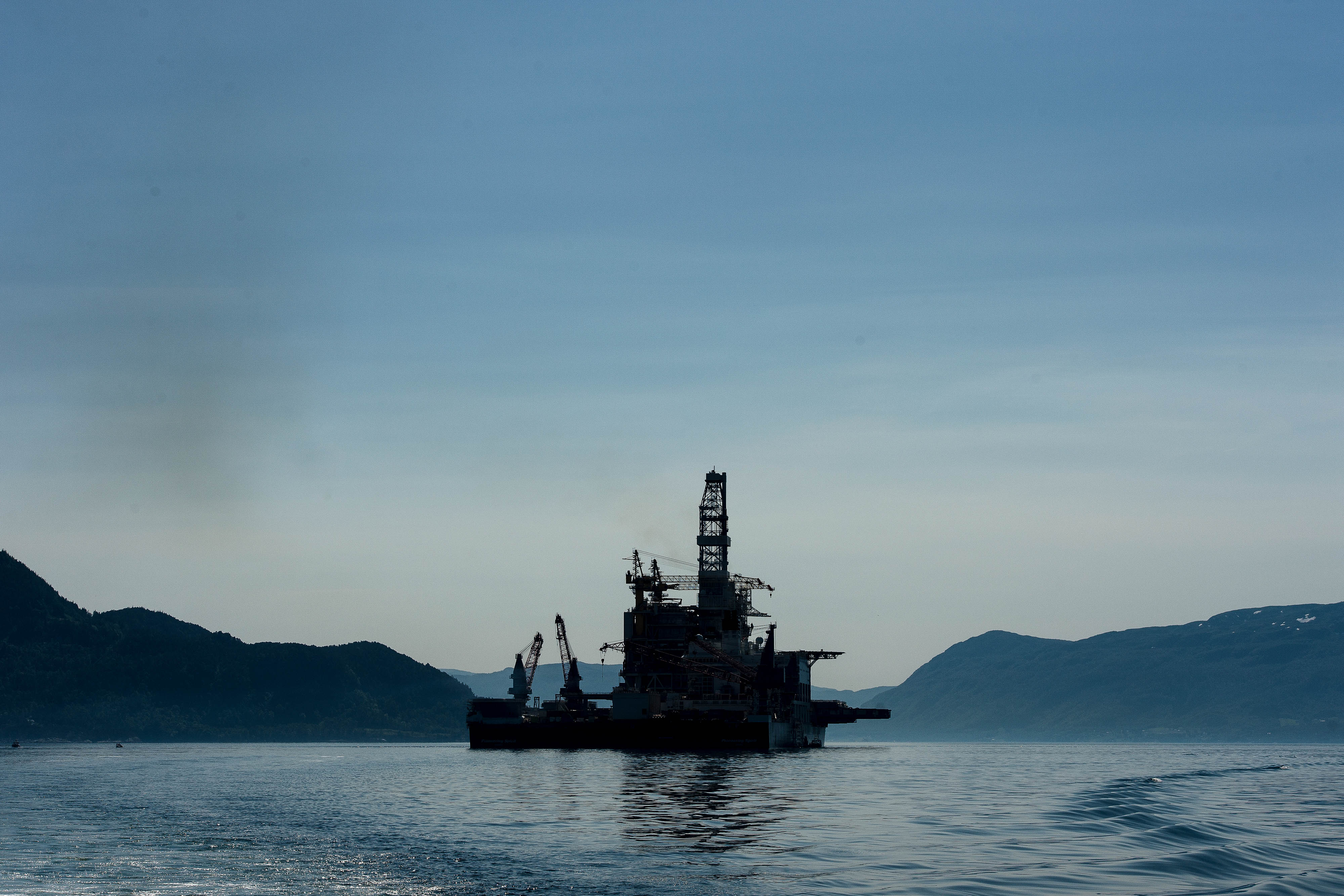 An oil drilling platform sits on board the world's largest construction vessel, the Pioneering Spirit, in the Bomla fjord near Leirvik, ahead of its transportation to the Johan Sverdrup oil field, Norway. Photographer: Carina Johansen/Bloomberg