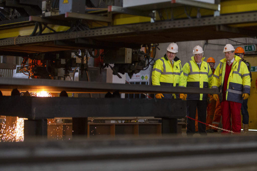 Scottish energy minister Paul Wheelhouse joined Sean Power of DF Barnes to inspect the yard.