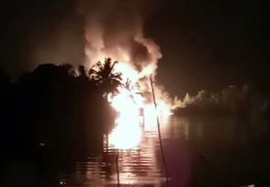 In this image made from video on Friday, March 1, 2019, fire is seen from a pipeline explosion in Nembe, Nigeria. More than 50 people are missing after a leaking oil pipeline exploded and caused a stampede in southern Nigeria, a local official said Saturday.
