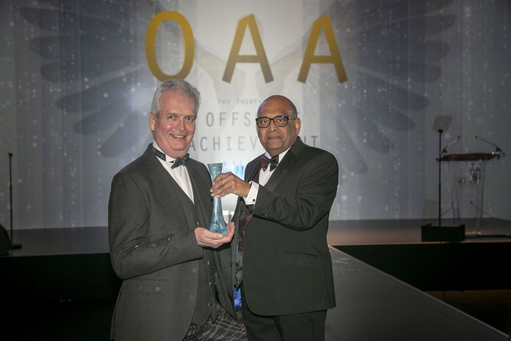 SPE Aberdeen chairman Ian Phillips, left, presents the significant contribution award to Denis Pinto at the 2019 Offshore Achievement Awards