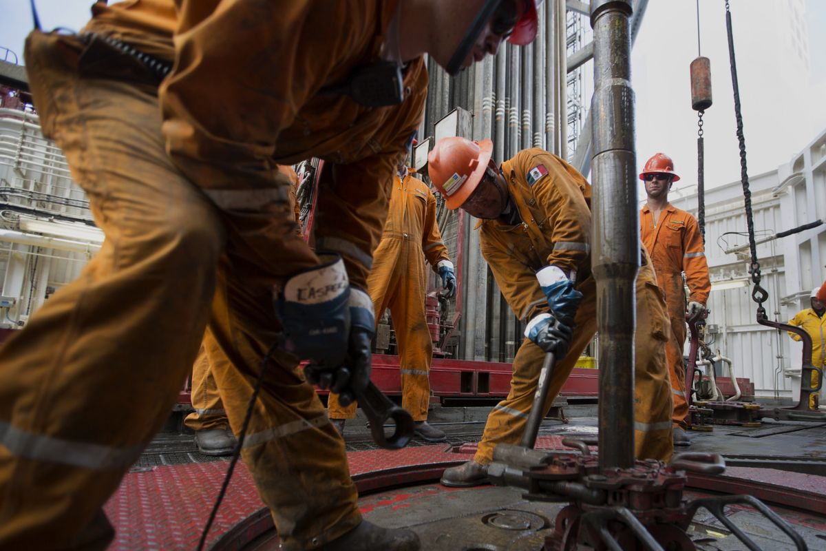 Workers prepare drilling pipe on the Petroleos Mexicanos (Pemex) La Muralla IV deep sea crude oil platform in the waters off Veracruz, Mexico, on Friday, Aug. 30, 2013.  Photographer: Susana Gonzalez/Bloomberg