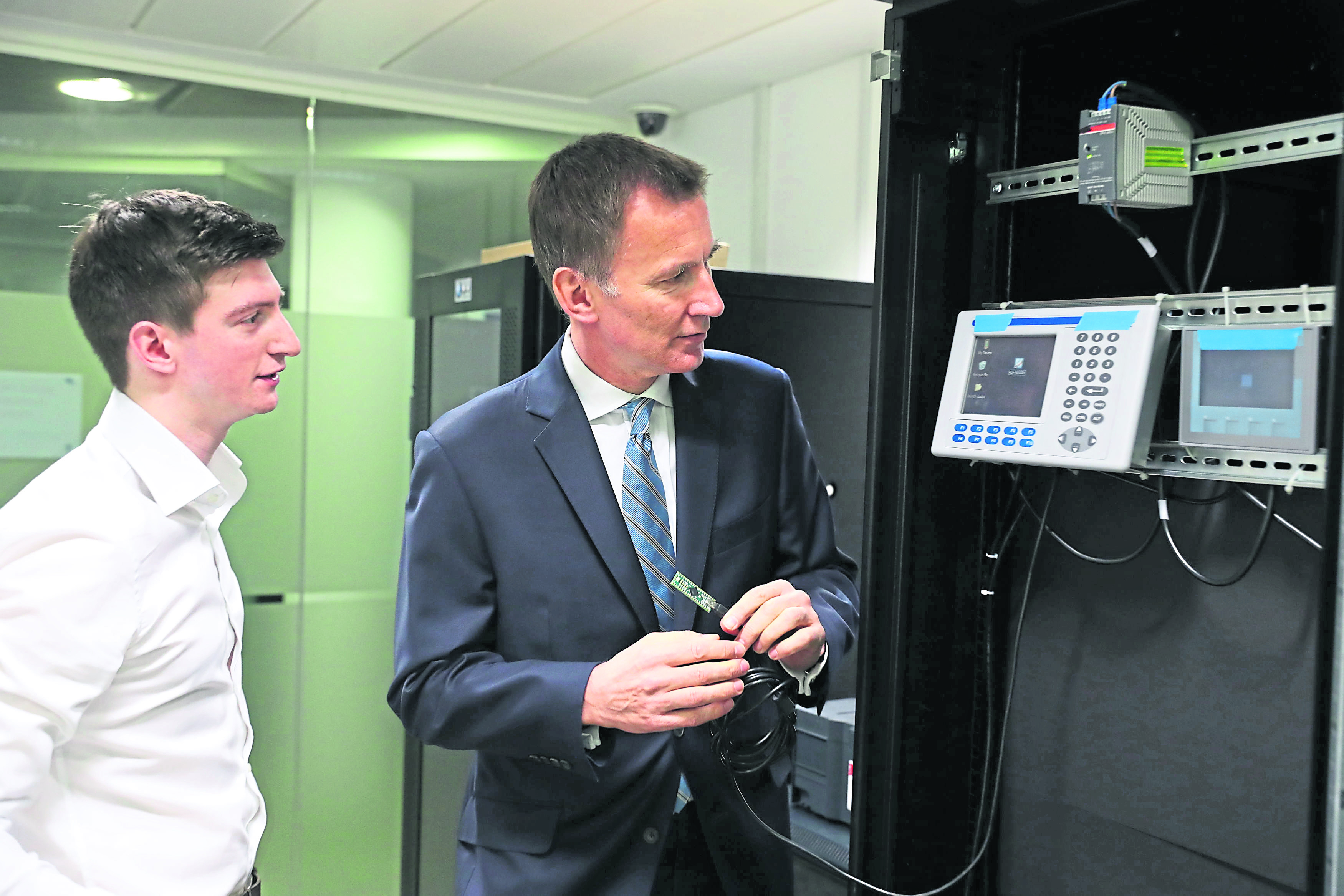 Foreign Secretary Jeremy Hunt creates a cyber attack during a demonstration with student Marco Cook as he visits the Sir Alwyn Williams Building at the University of Glasgow ahead of his speech on Defending Democracy in the Cyber Age. PRESS ASSOCIATION Photo. Picture date: Thursday March 7, 2019. See PA story POLITICS Hunt. Photo credit should read: Andrew Milligan/PA Wire