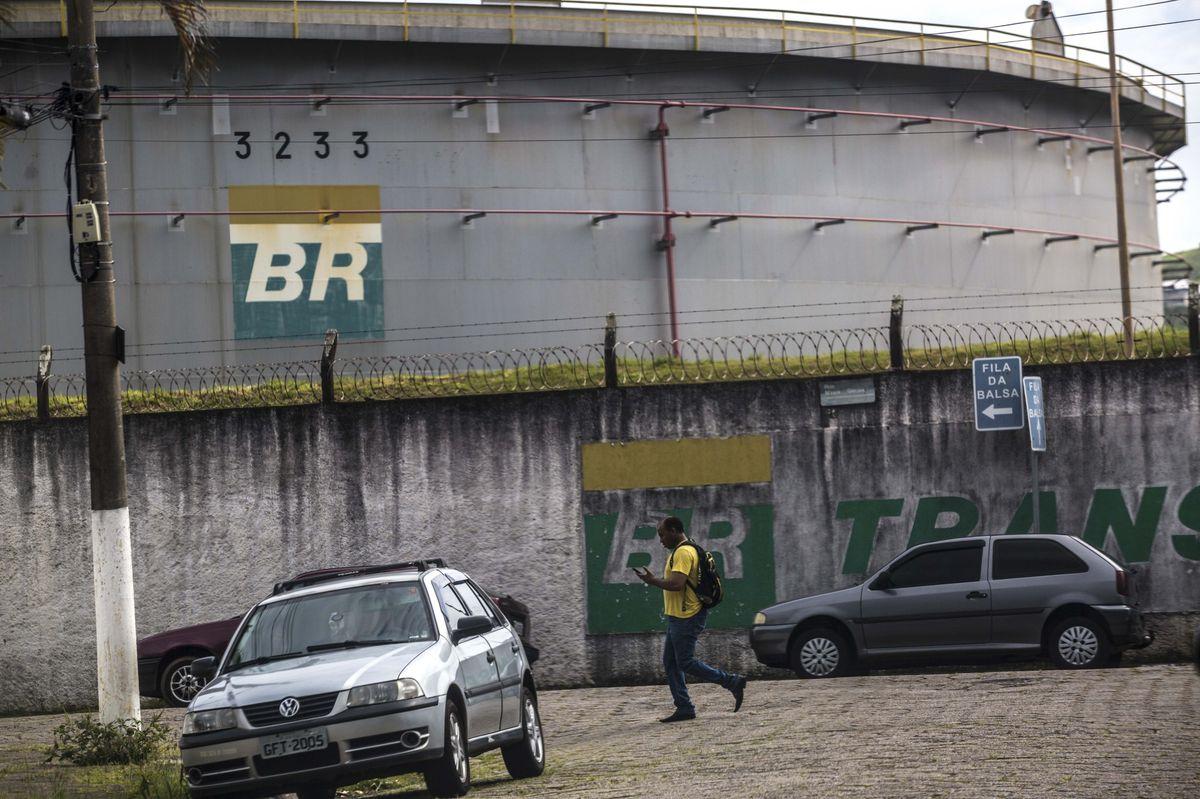 A man walks past an oil storage tank at the Petrobras Transporte SA (Transpetro) sea terminal in Sao Sebastiao, Sao Paulo state, Brazil, on Wednesday, Dec. 19, 2018.  Photographer: Dado Galdieri/Bloomberg