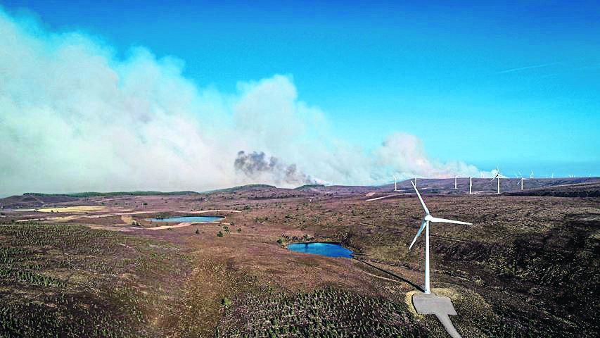 Smoke can be seen filling the sky as the wildfire creeps nearer to the turbines of Paul's Hill Wind Farm at Knockando. Pictures courtesy of William Bird