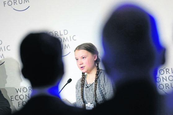 powerful: Nobel-nominated activist Greta Thunberg, 16, delivering her speech during the World Economic Forum