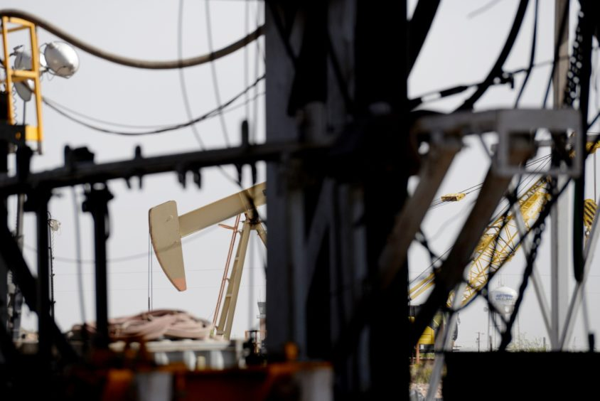 A pumpjack is seen as U.S. Vice President Mike Pence, not pictured, tours a Diamondback Energy Inc. oil rig in Midland, Texas, U.S., on Wednesday, April 17, 2019. Pence gave remarks to employees regarding the impacts of the Administration's United States-Mexico-Canada Agreement. Photographer: Callaghan O'Hare/Bloomberg