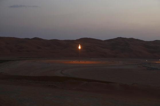 Flames burn off at an oil processing facility in Saudi Aramco's oilfield in the Rub' Al-Khali (Empty Quarter) desert in Shaybah, Saudi Arabia, on Tuesday, Oct. 2, 2018.  Photographer: Simon Dawson/Bloomberg