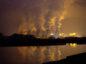 Chimneys emit vapor at Jaenschwalde lignite power plant in Germany, operated Vattenfall. Photographer: Krisztian Bocsi/Bloomberg