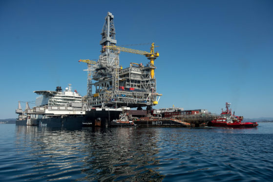 The H-627 barge carrier transports an oil drilling platform onto the world's largest construction vessel, the Pioneering Spirit, in the Bomla fjord near Leirvik, ahead of its transportation to the Johan Sverdrup oil field, Norway, on Friday, June 1, 2018.  Photographer: Carina Johansen/Bloomberg