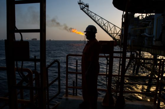 A gas flame burns from a pipe close to an offshore oil platform in the Persian Gulf's Salman Oil Field, operated by the National Iranian Offshore Oil Co., near Lavan island, Iran. Photographer: Ali Mohammadi/Bloomberg