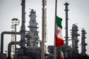 An Iranian national flag flies near gas condensate processing facilities in the new Phase 3 facility at the Persian Gulf Star Co. (PGSPC) refinery in Bandar Abbas, Iran, on Wednesday, Jan. 9. 2019.  Photographer: Ali Mohammadi/Bloomberg
