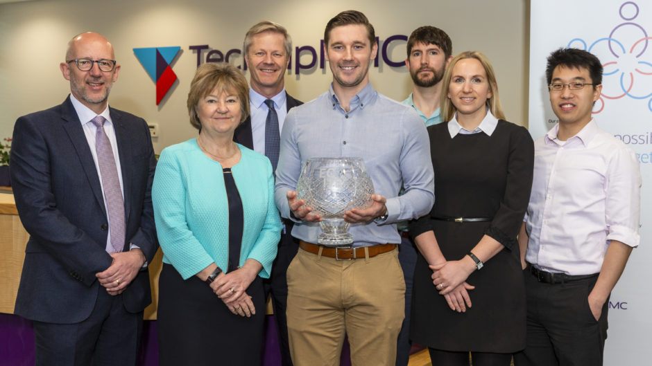 The photo caption is: (left to right):  Bill Morrice, Lynda Armstrong (ECITB Chair), Chris Claydon (behind), Steven Gillan, Shaun Riddell, Katie Roberts and Zane Tan.