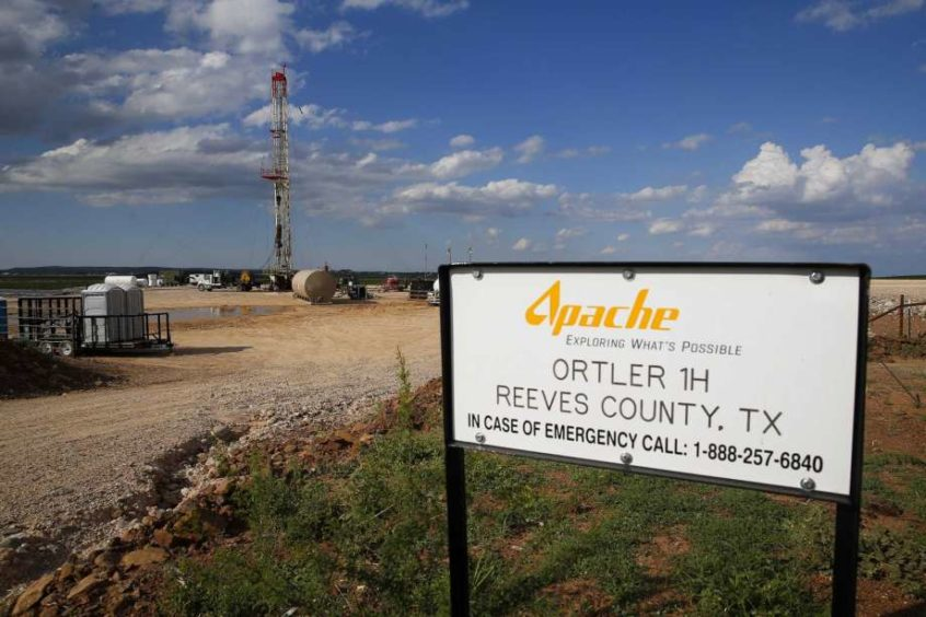 A drilling rig sits north of the Davis Mountains Friday, Sept. 16, 2016 in Balmorhea.