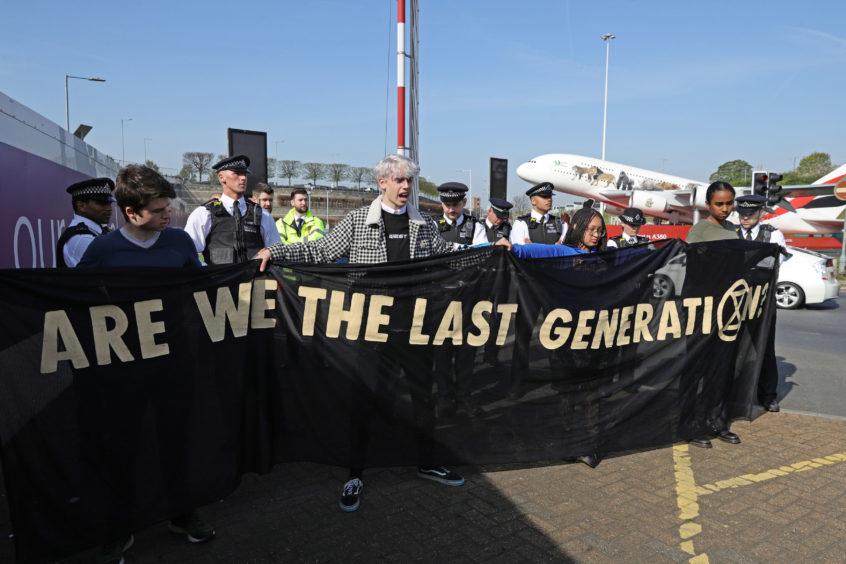 Extinction Rebellion demonstrators at London Heathrow airport.