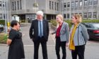 WEstern Isles Council's Iain Maviver welcomes Ofgems senior officials Cathryn Scott, Beth Hanna and Lois Griffin to Stornoway.