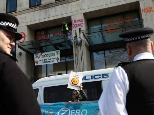 Environmental campaigners protest outside a Shell Oil building during a coordinated protest by the Extinction Rebellion group on April 15, 2019 in London, England.  Photographer: Dan Kitwood/Getty Images