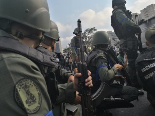 A group of National Guard members supporting Venezuelan opposition leader Juan Guaido gather during a military uprising near the La Carlota base in Caracas, Venezuela, on Tuesday, April 30, 2019. Guaido on Tuesday went to a military base in the nation's capital to proclaim the end of socialist President Nicolas Maduro's regime and called for a military uprising. Photographer: Carlos Becerra/Bloomberg