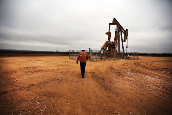 GARDEN CITY, TX - FEBRUARY 05: An oil well owned an operated by Apache Corporation in the Permian Basin are viewed on February 5, 2015 in Garden City, Texas.