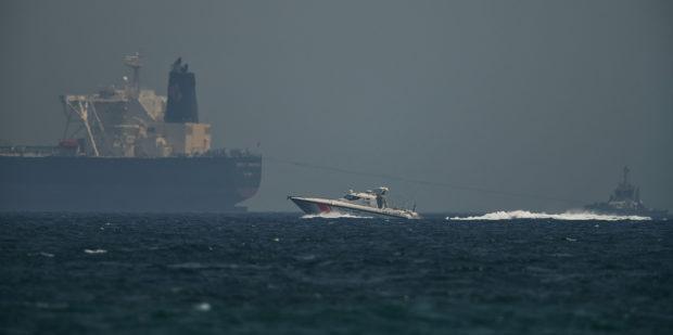 An Emirati coast guard vessel passes an oil tanker off the coast of Fujairah, United Arab Emirates, Monday, May 13, 2019.