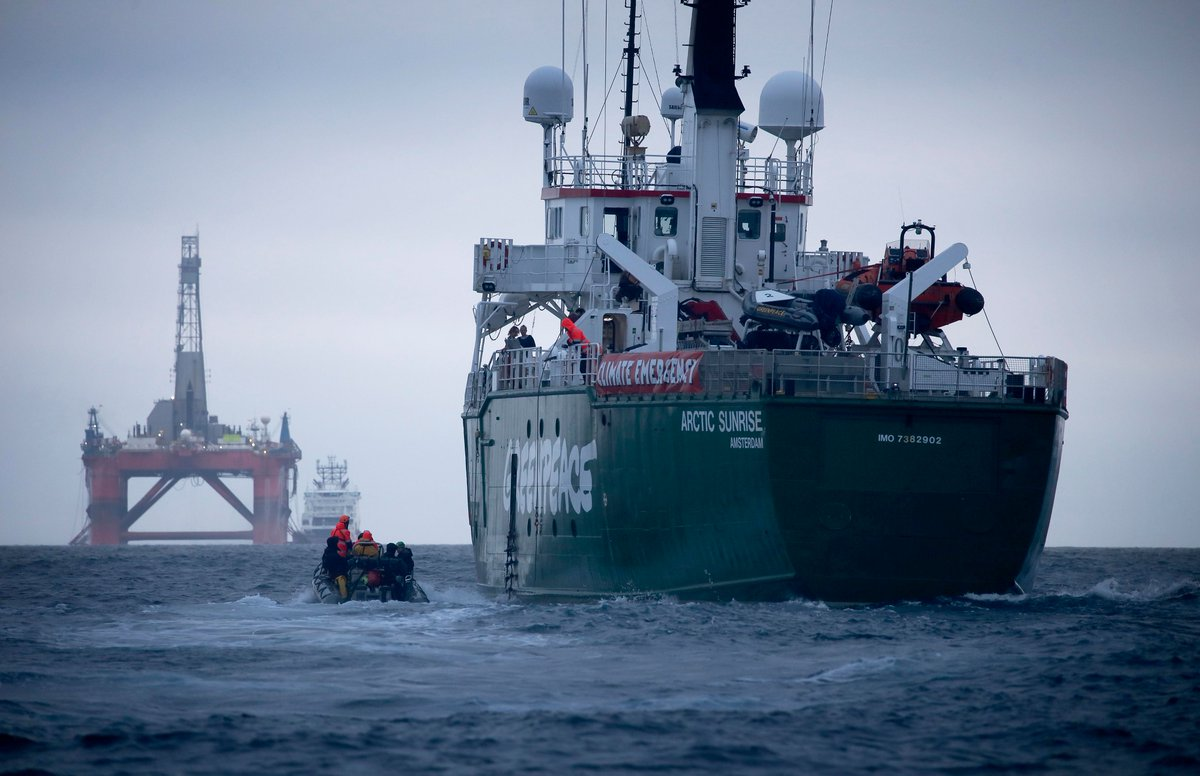 Arctic Sunrise with the Transocean Paul B Lloyd Jr rig in the background. Pic: Greenpeace