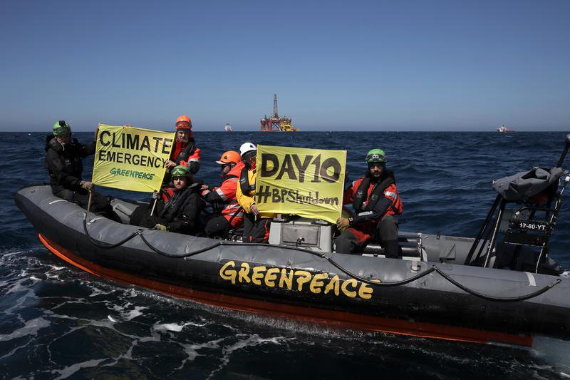 Greenpeace protestors in the North Sea with Paul B Loyd Jr in the background