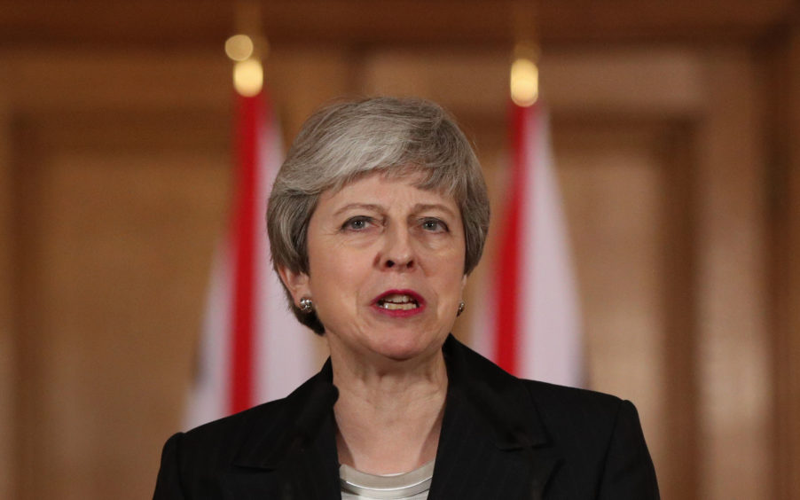 Theresa May has announced the UK Government will set a legally binding target today of net zero emissions by 2050. Pic Jonathan Brady/PA Wire
