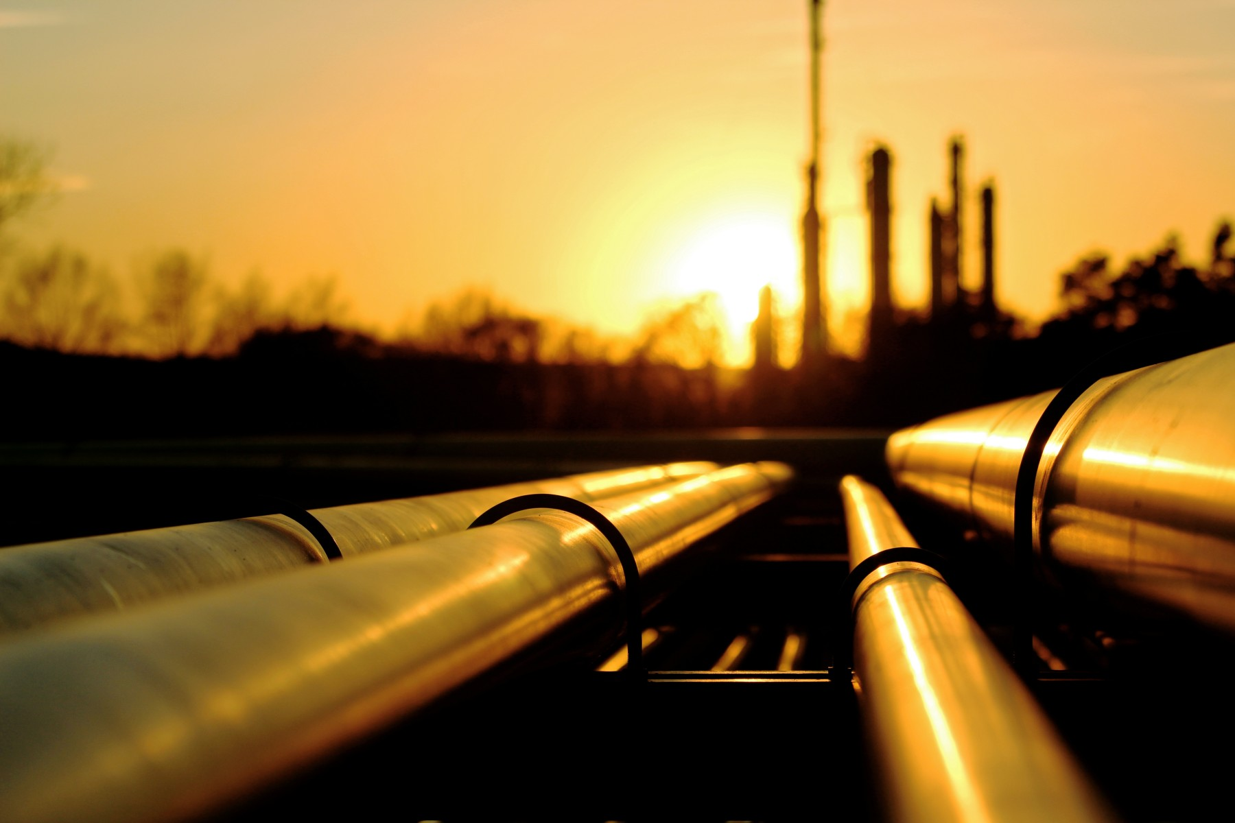 Sunrise over oil pipelines.