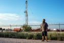 Blake Roberts poses for a photo near his home in Andrews, Texas on Thursday, July 11, 2019. Roberts and his family are strong supporters of WCS's effort to begin work on a high level nuclear waste dump site. Roberts said he would have no second thoughts about any impacts on safety to the area and he believes it would help the community to not be so reliant on gas and oil. Photographer: Sergio Flores/Bloomberg