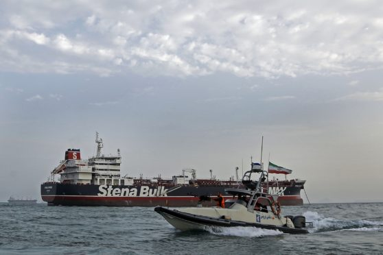 A picture taken on July 21, 2019, shows Iranian Revolutionary Guards patrolling around the British-flagged tanker Stena Impero as it's anchored off the Iranian port city of Bandar Abbas. - Iran warned Sunday that the fate of a UK-flagged tanker it seized in the Gulf depends on an investigation, as Britain said it was considering options in response to the standoff. Authorities impounded the Stena Impero with 23 crew members aboard off the port of Bandar Abbas after the Islamic Revolutionary Guard Corps seized it Friday in the highly sensitive Strait of Hormuz. (Photo by Hasan Shirvani / MIZAN NEWS AGENCY / AFP)        (Photo credit should read HASAN SHIRVANI/AFP/Getty Images)