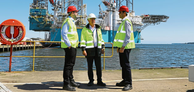 Luiz Rozo, Callum Falconer, chief executive of Dundeecom, and Ricardo Luca on a tour of Dundee Port.