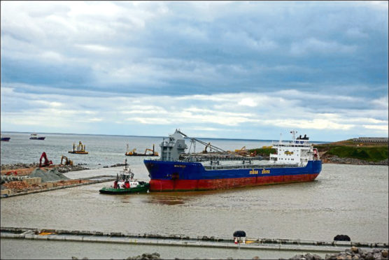 An investigation was launched earlier this month after claims the MV Beltnes was left berthed in the harbour for several days after scraping the bottom.