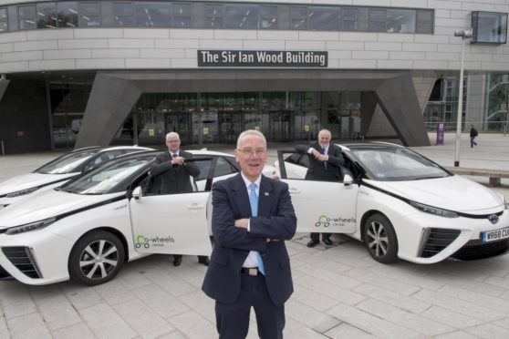 From left, RGU Director of Estates and Properties Services Bill Somerville, Councillor Philip Bell and Co-wheels Car Club Scotland Manager Tony Archer