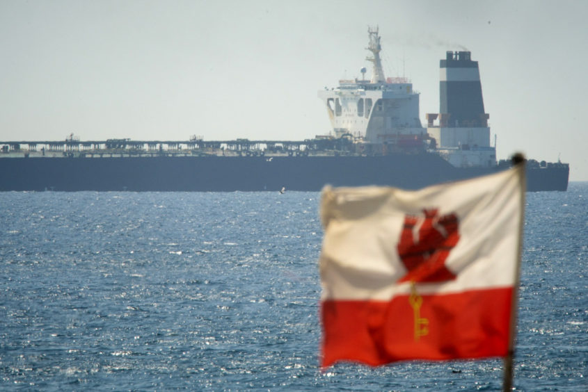 A view of the Grace 1 super tanker in the British territory of Gibraltar, Thursday, July 4, 2019. Spain's acting foreign minister says a tanker stopped off Gibraltar and suspected of taking oil to Syria was intercepted by British authorities after a request from the United States. (AP Photo/Marcos Moreno)