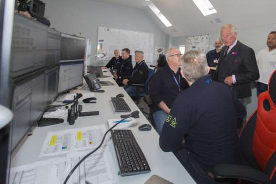 Prince Charles chats with marine co-ordinator Colin Brown and Gordon Morrison in the Beatrice Offshore Windfarm control room at Wick Harbour. Photo: Robert MacDonald/Northern Studios