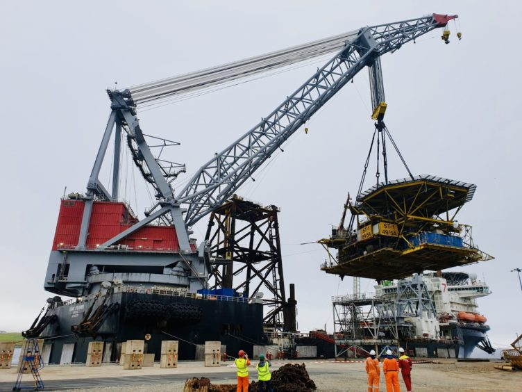 The ST-1 topside and jacket being delivered to Dales Voe in Shetland.