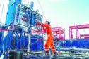 Offshore oil and gas industry, worker inspect and setting up top side tools for safety first to perforation oil and gas production well.