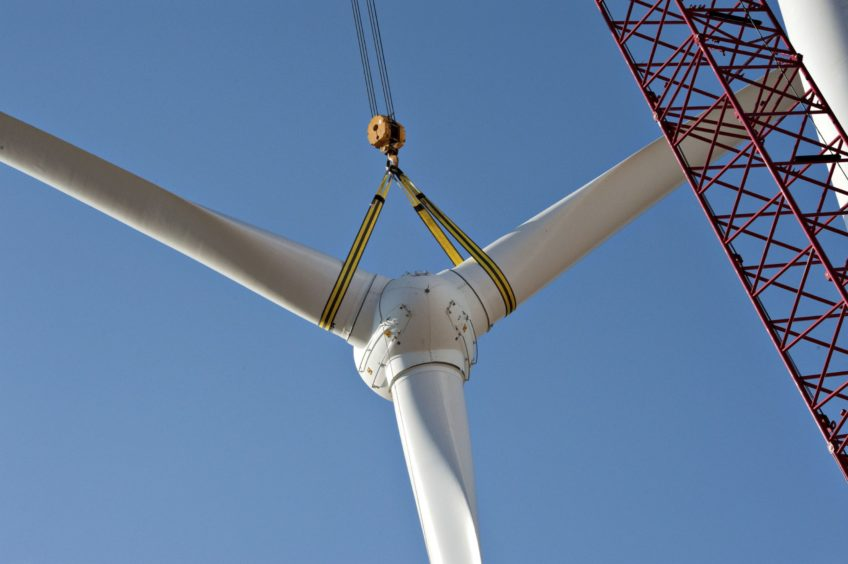 A rotor assembly is raised into position during construction of of a wind turbine at the Edison Mission Group Big Sky wind farm in Ohio, Illinois, U.S., on Wednesday, Sept. 29, 2010. When complete, the Big Sky wind farm, owned by Edison Mission Group, a subsidiary of Edison International Co., will contain 114 Suzlon Energy Ltd. turbines capable of producing a total of 240 megawatts of electricity. Photographer: Daniel Acker/Bloomberg