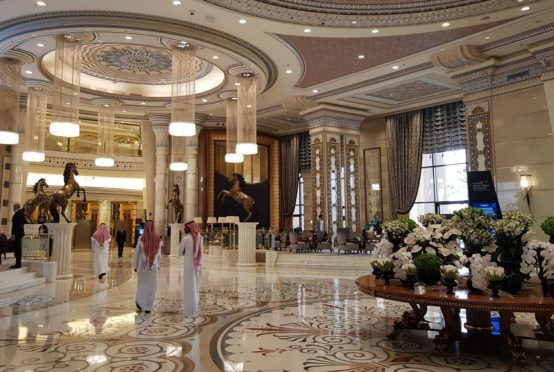 Participants walk through the foyer of the Ritz Carlton Hotel during preparations ahead of the Future Investment Initiative (FII) conference in Riyadh, Saudi Arabia, on Monday, Oct. 22, 2018. Saudi Arabia planned to announce a raft of deals in energy and base metals at its signature investment forum even as it struggled to overcome international outrage over the killing of a government critic.Photographer: Javier Blas/Bloomberg