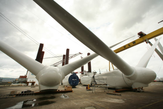 Partially constructed wind turbine blades are stored at the Harland & Wolff shipyard on August 14, 2008 in Belfast, Northern Ireland. (Photo by Peter Macdiarmid/Getty Images)