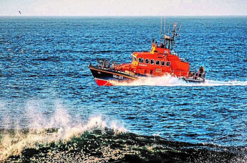Fraserburgh lifeboat out searching between Tarlair and Troup Head