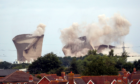 The cooling towers at the disused coal-fired Didcot power station in Oxfordshire are demolished. Steve Parsons/PA Wire