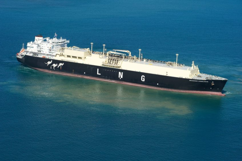 An LNG carrier carries supplies from Pluto LNG