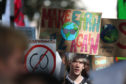 A protester at the UK Student Climate Network's Global Climate Strike in London. PA Photo. Picture date: Friday September 20, 2019. Young climate strikers across the country are taking to the streets as part of a global protest to demand urgent action to tackle climate change. Gareth Fuller/PA Wire
