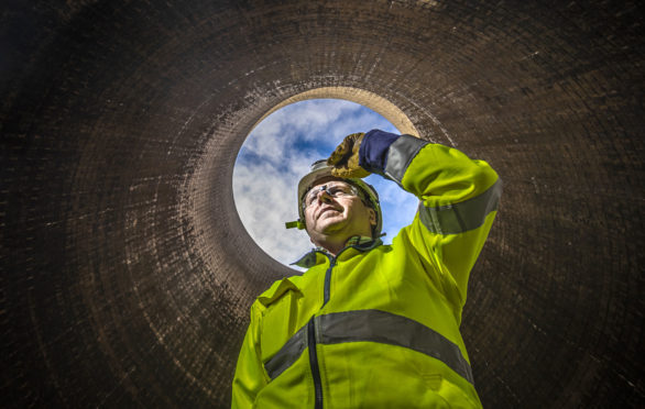 A worker in a cooling tower at Ferrybridge C Power Station in West Yorkshire, before the plant's cooling towers are demolished in October. PA Photo. Picture date: Thursday September 12, 2019. Photo credit should read: Danny Lawson/PA Wire