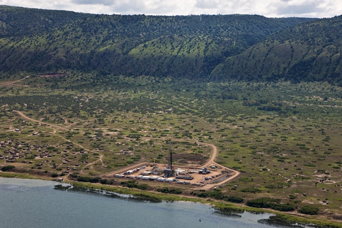 The Ugandan government and Tullow have reached an agreement on tax, paving the way for the sale to Total of a 33.3% stake in the Lake Albert project.