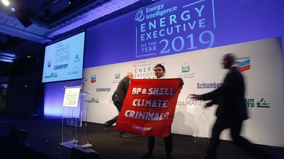 Greenpeace activists took to the stage at the Oil and Money conference last night