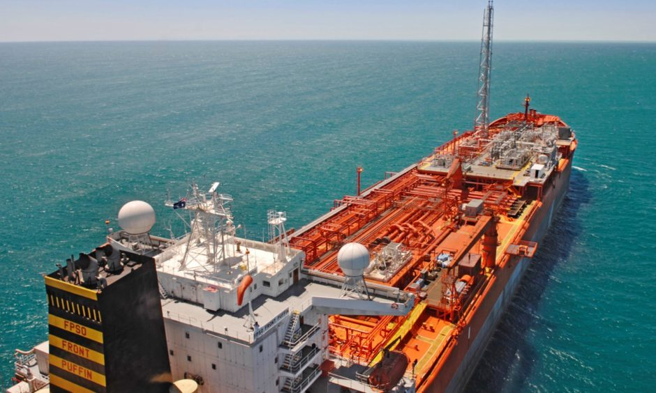 An FPSO floats on a blue sea