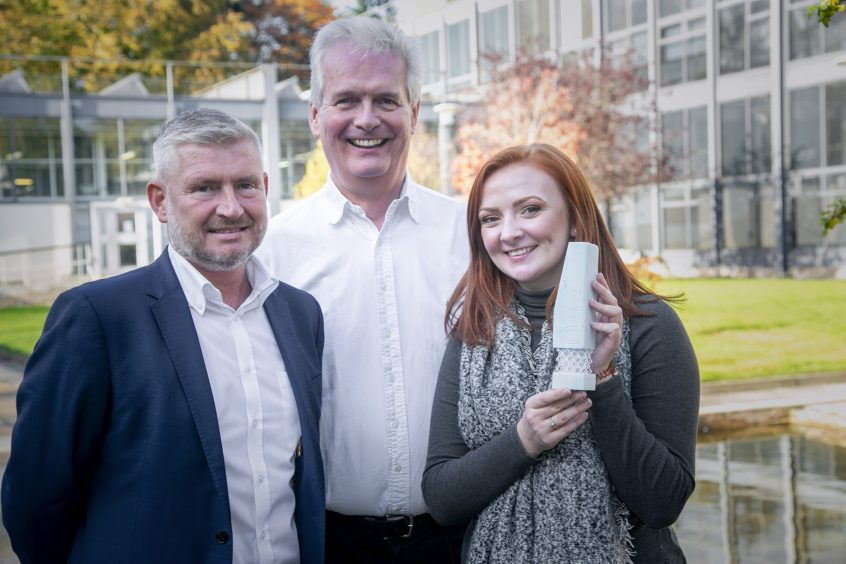 From left: Pete Baker from TAQA, Ian Phillips from SPE and Rachel Mackay, competition winner.