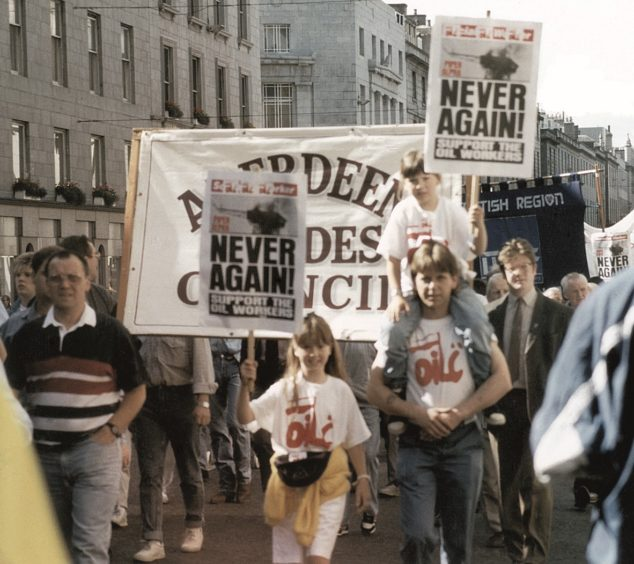 """Protests in 1989, a year after Piper Alpha, urging the government to """"bring the men up now"""". 30 bodies were never recovered after Piper Alpha, when 167 people died."""